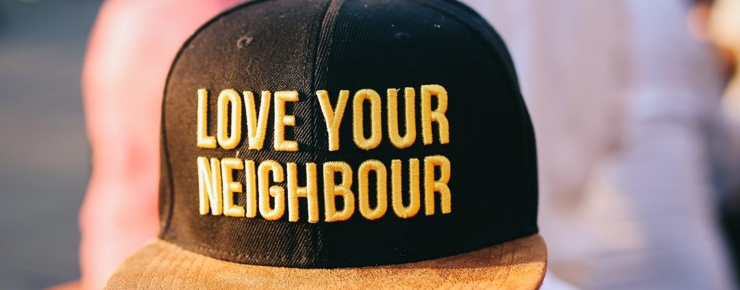 Hat that says Love your neighbour
